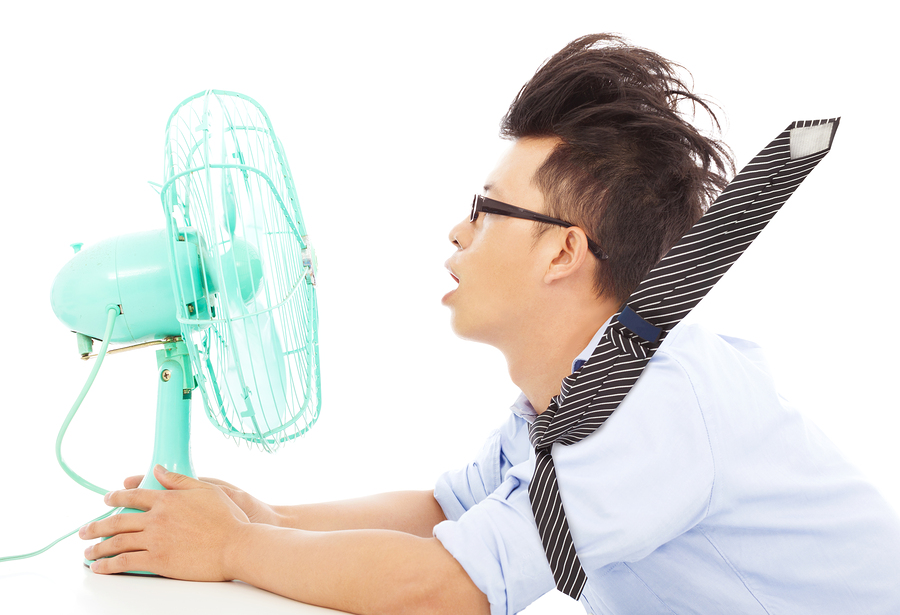 Man using fan to stay cool in West Chester, PA