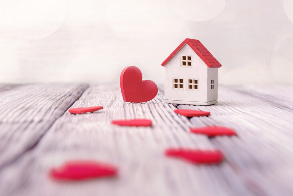 Little wooden house with red hearts