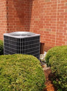 outside residential air conditioning unit by a building